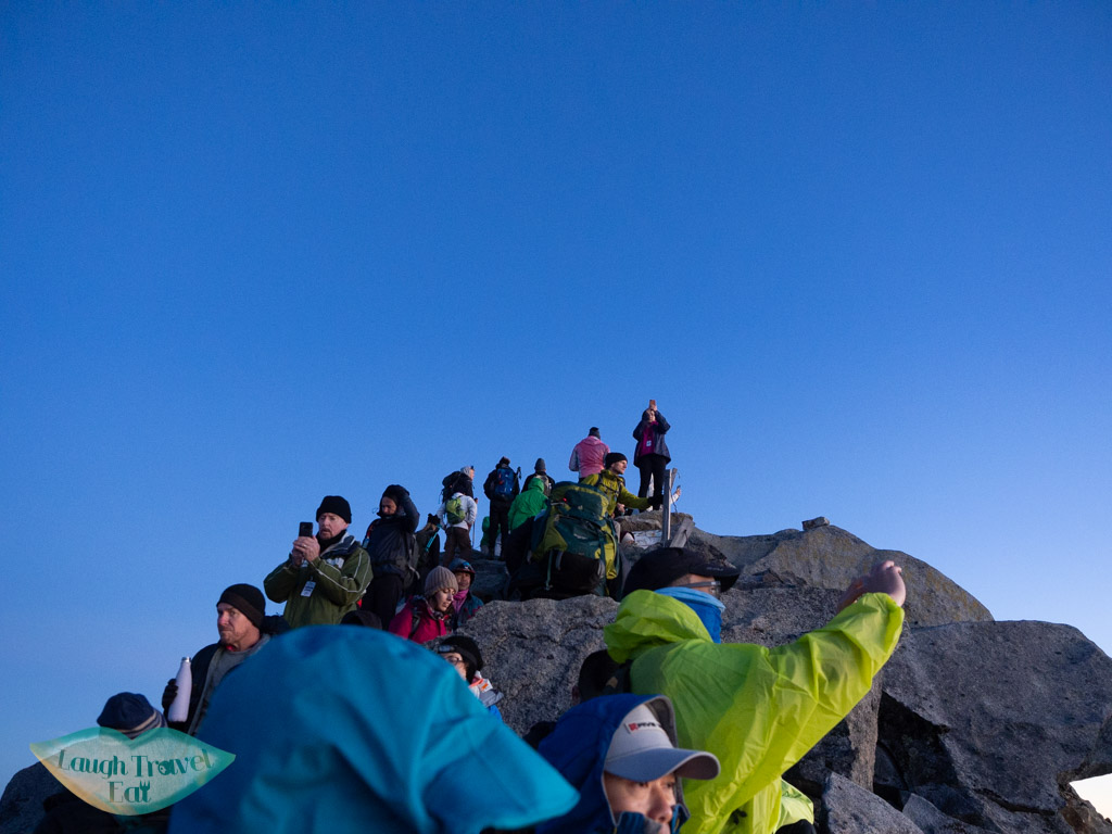 crowd-awaiting-sunrise-on-lows-peak-mount-kinabalu-sabah-malaysia-laugh-travel-eat