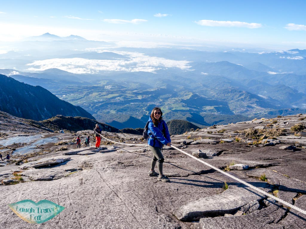 pretend-to-propel-down-mount-kinabalu-sabah-malaysia-laugh-travel-eat