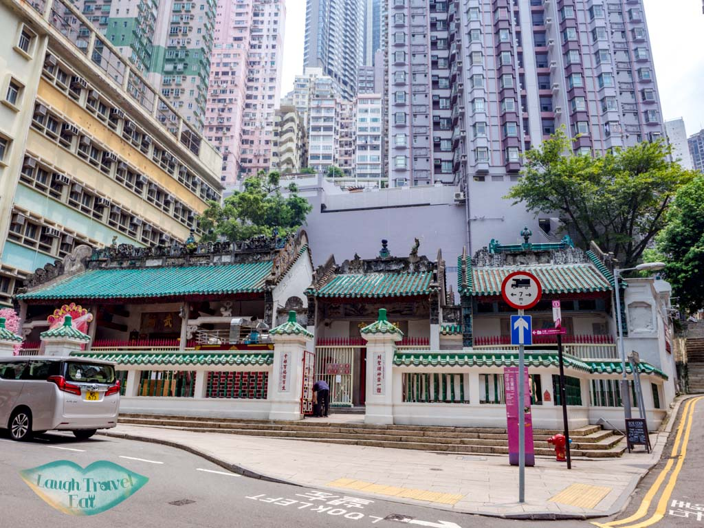 front of Man Mo Temple sheung wan hong kong - laugh travel eat