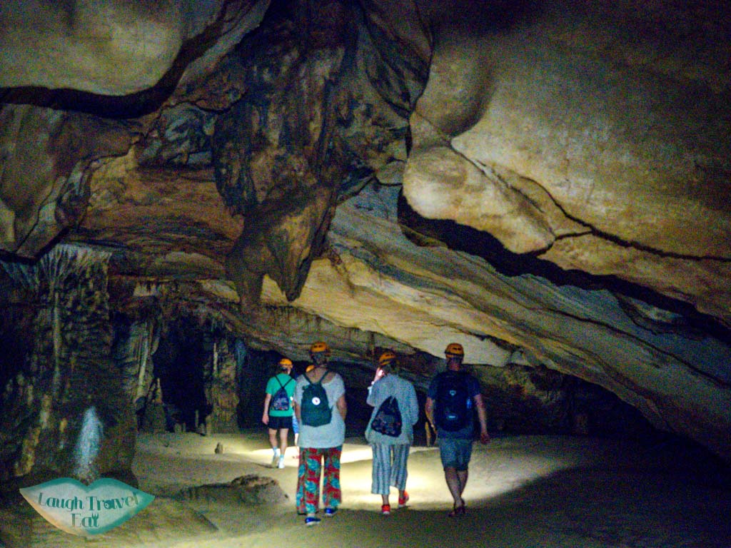 walking in the caves paradise cave phong nha vietnam - laugh travel eat