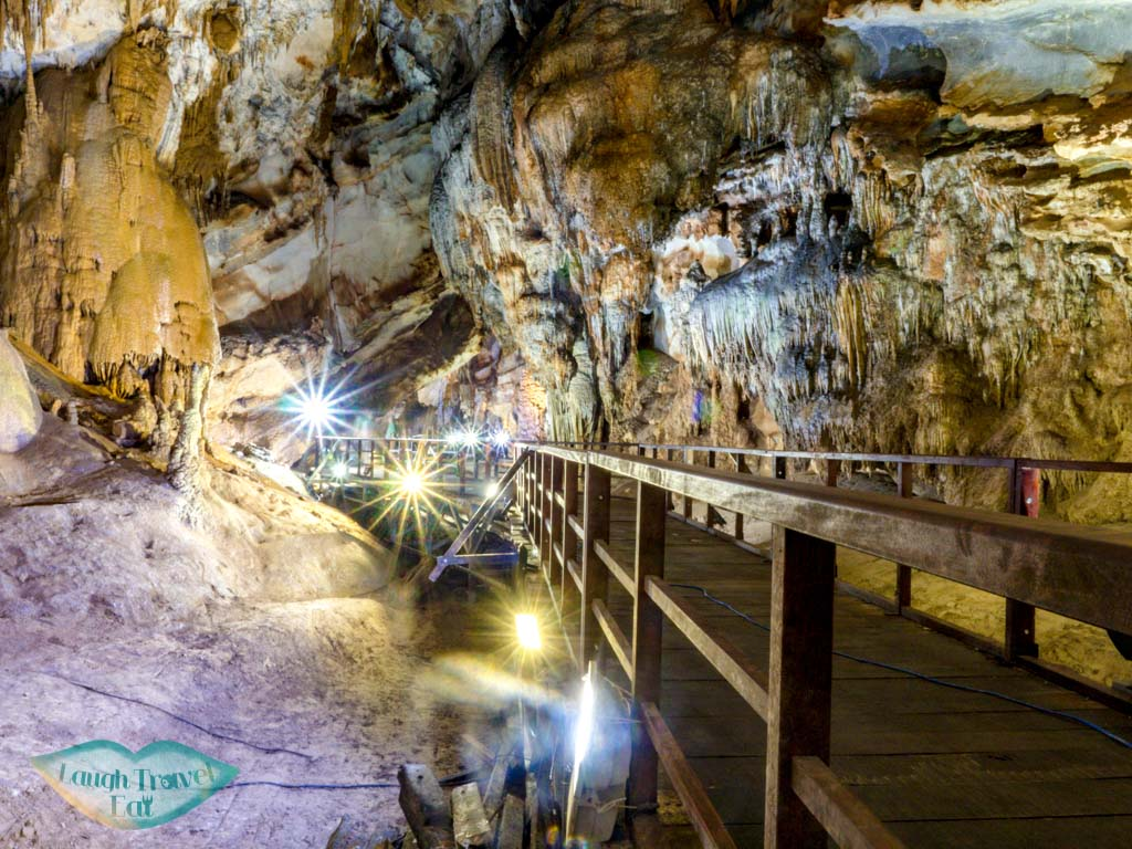 empty walkway paradise cave phong nha vietnam - laugh travel eat