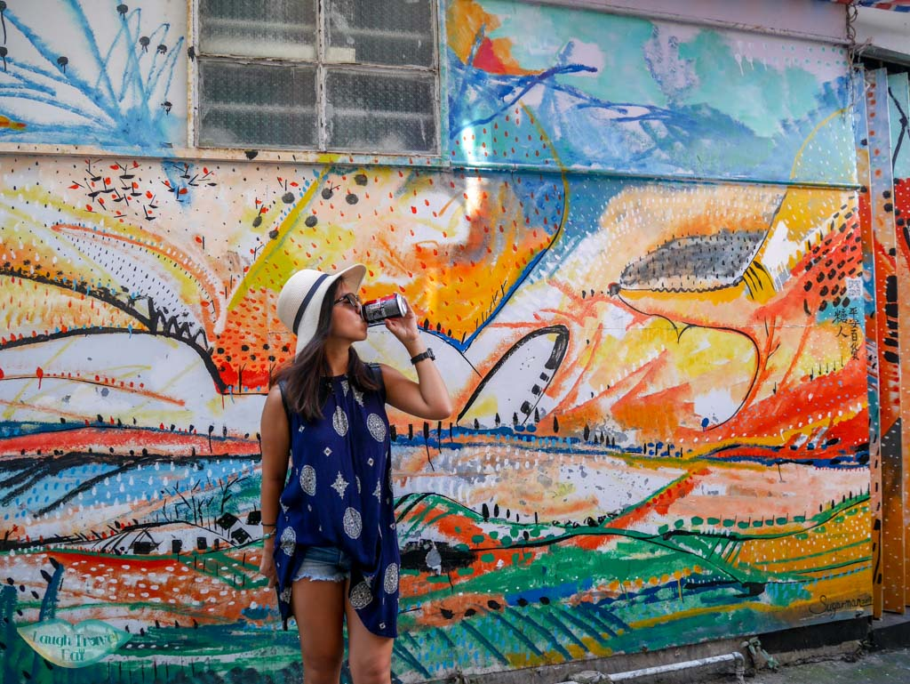 me drinking cola colourful wall Cheung Chau, Hong Kong - Laugh Travel Eat