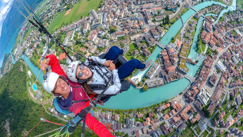 birds eye view paragliding interlaken Switzerland - laugh travel eat