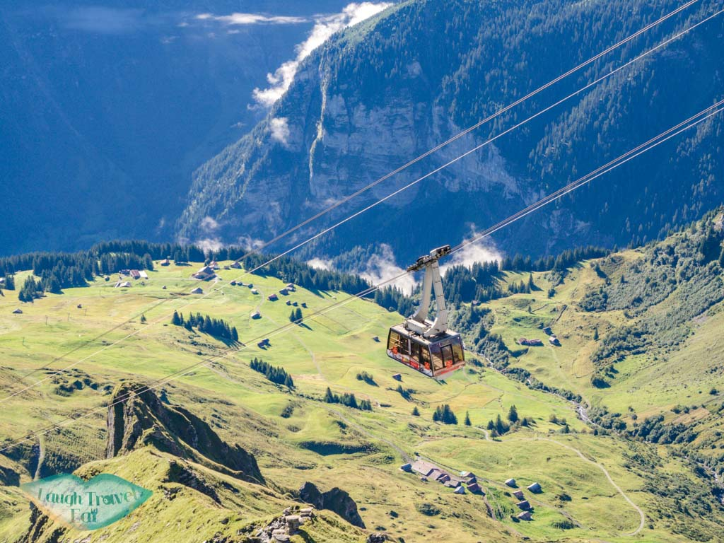 cable car going up and down schilthorn switzerland - laugh travel eat