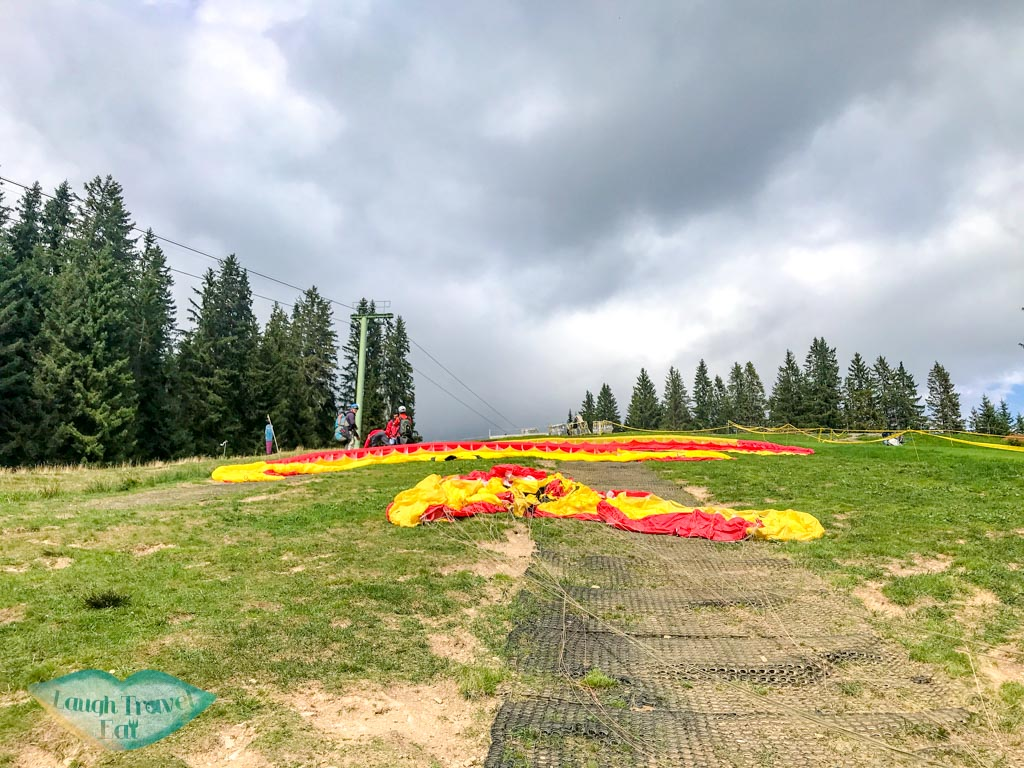 getting ready for paragliding interlaken Switzerland - laugh travel eat