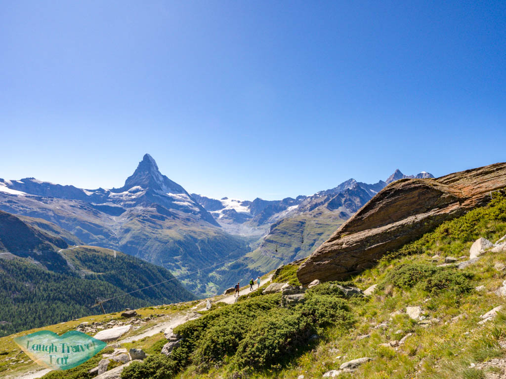 looking back from blauherd to stellisee zermatt switzerland - laugh travel eat