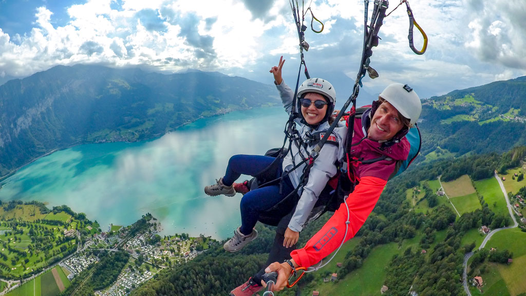 paragliding over interlaken Switzerland - laugh travel eat