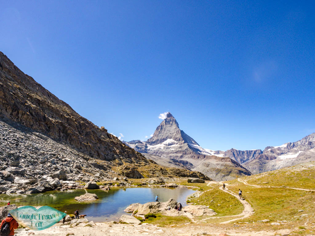 small lake before riffelsee zermatt switzerland - laugh travel eat