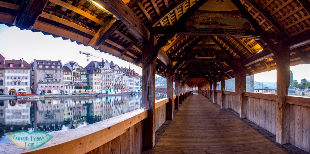 walking along chapel bridge lucerne switzerland - laugh travel eat