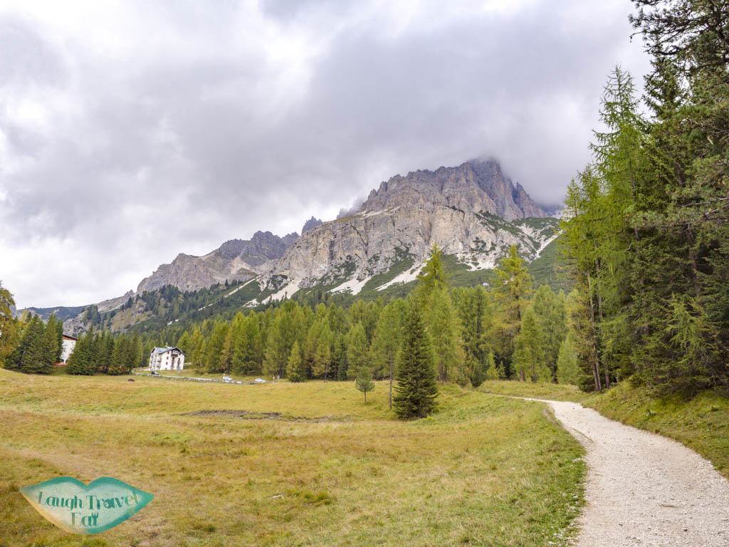 looking back at trail start lake sorapis hike cortina d'ampezzo dolomites italy - laugh travel eat