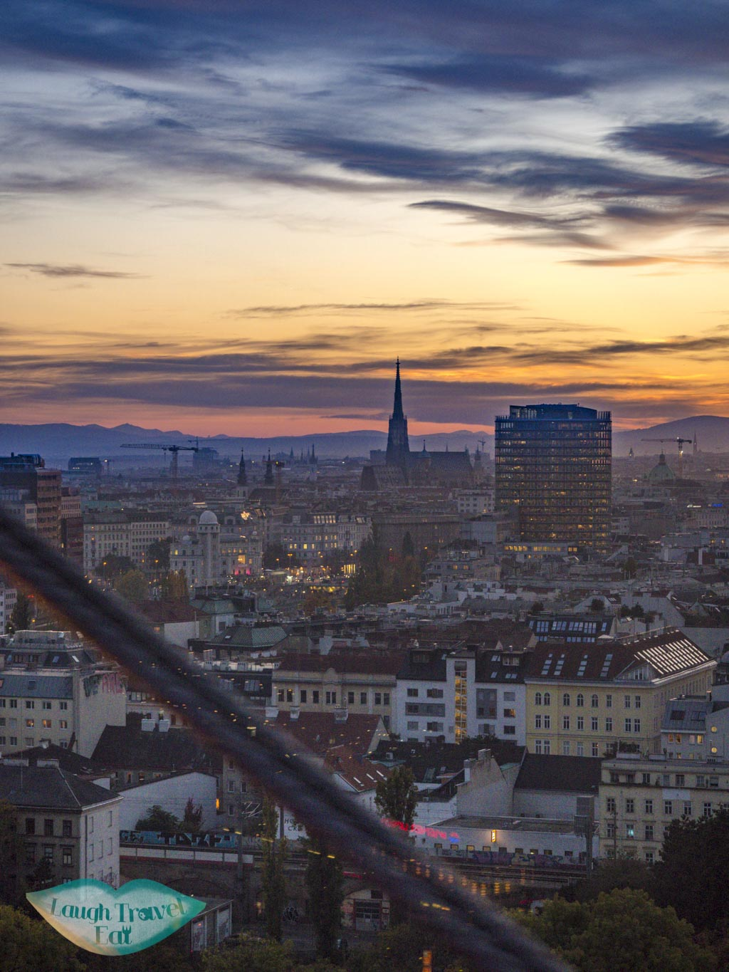 sunset view from ferris wheel vienna austria - laugh travel eat