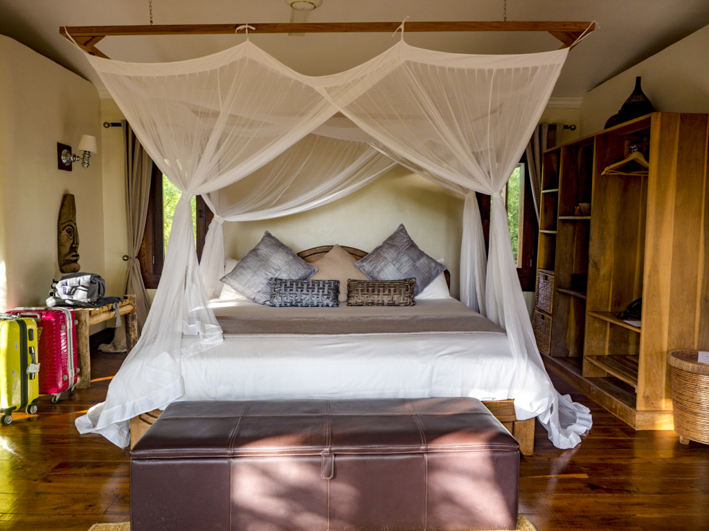 bed in escarpment luxury lodge tanzania africa - laugh travel eat