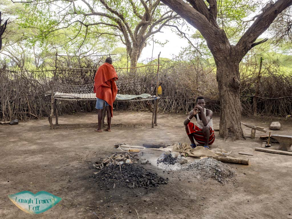 blacksmith datoga village tanzania africa - laugh travel eat