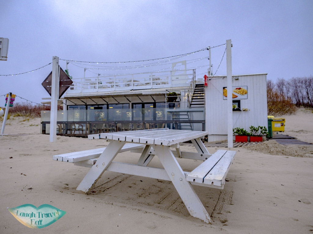 red sun buffet by white sand beach liepaja latvia - laugh travel eat