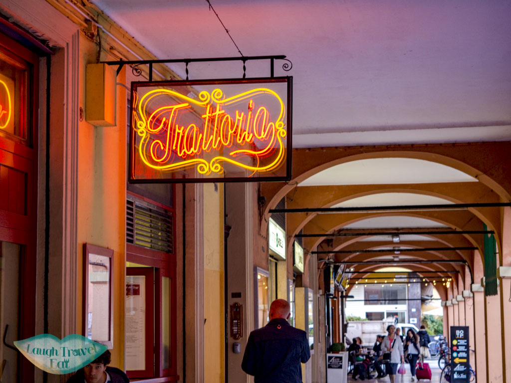 restaurants at a covered walkway bologna emilia romagna italy - laugh travel eat-2