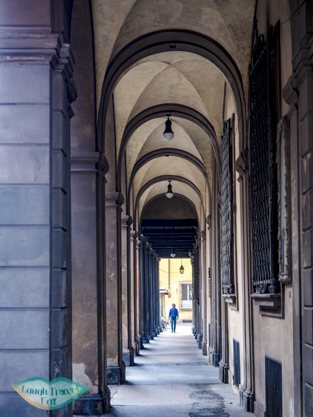 restaurants at a covered walkway bologna emilia romagna italy - laugh travel eat-3