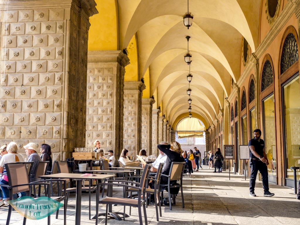 restaurants at a covered walkway bologna emilia romagna italy - laugh travel eat