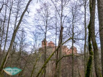 turaida castle from afar gauja national park latvia - laugh travel eat