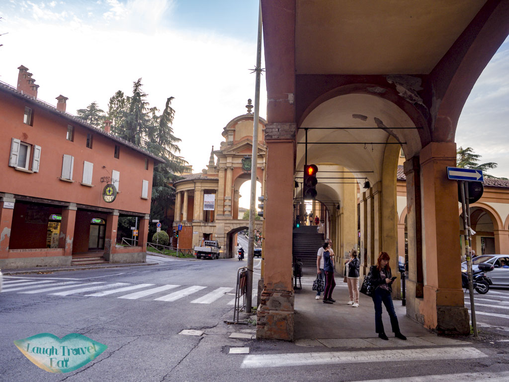 turning uphill san luca portico walk bologna italy - laugh travel eat