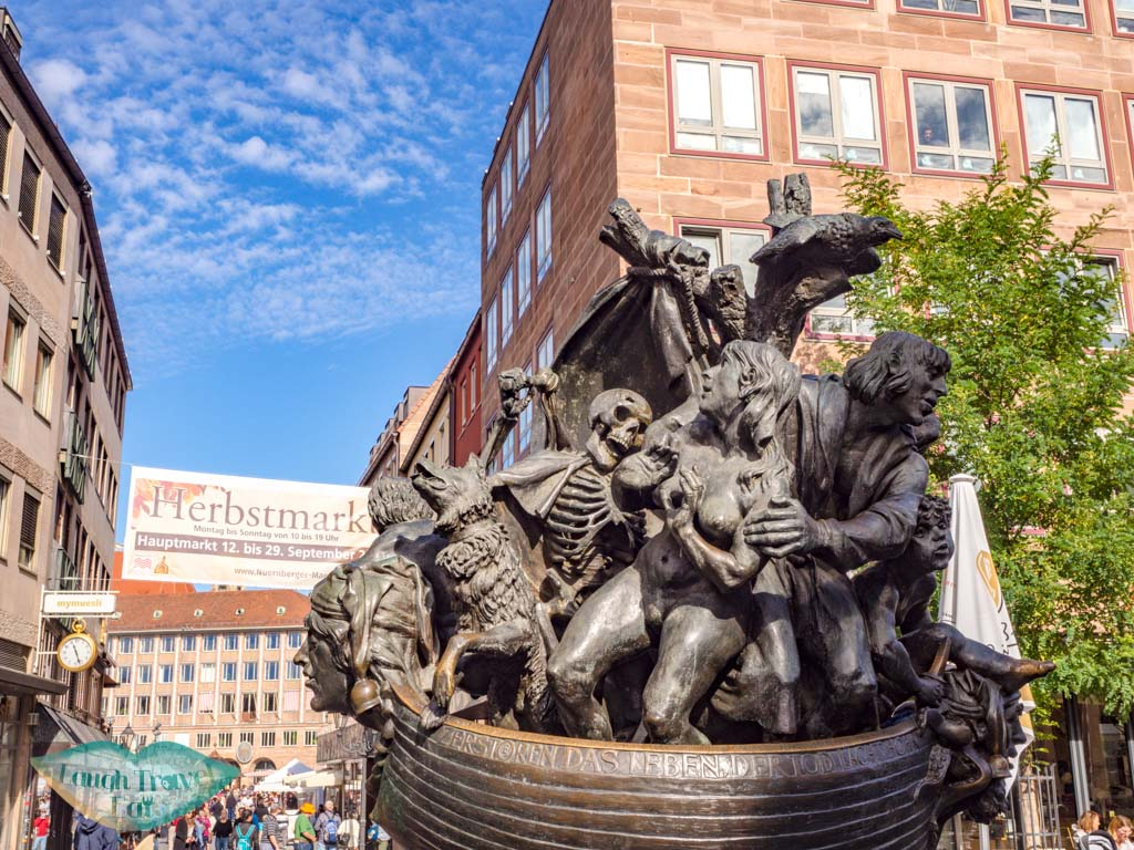 Narrenschiff fountain nuremberg germany - laugh travel eat