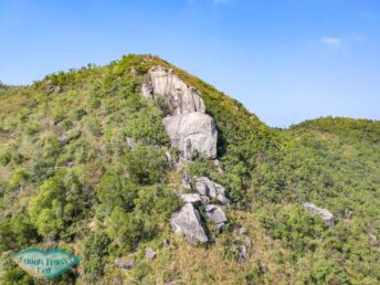rock outcrop on nui po shan hong kong - laugh travel eat