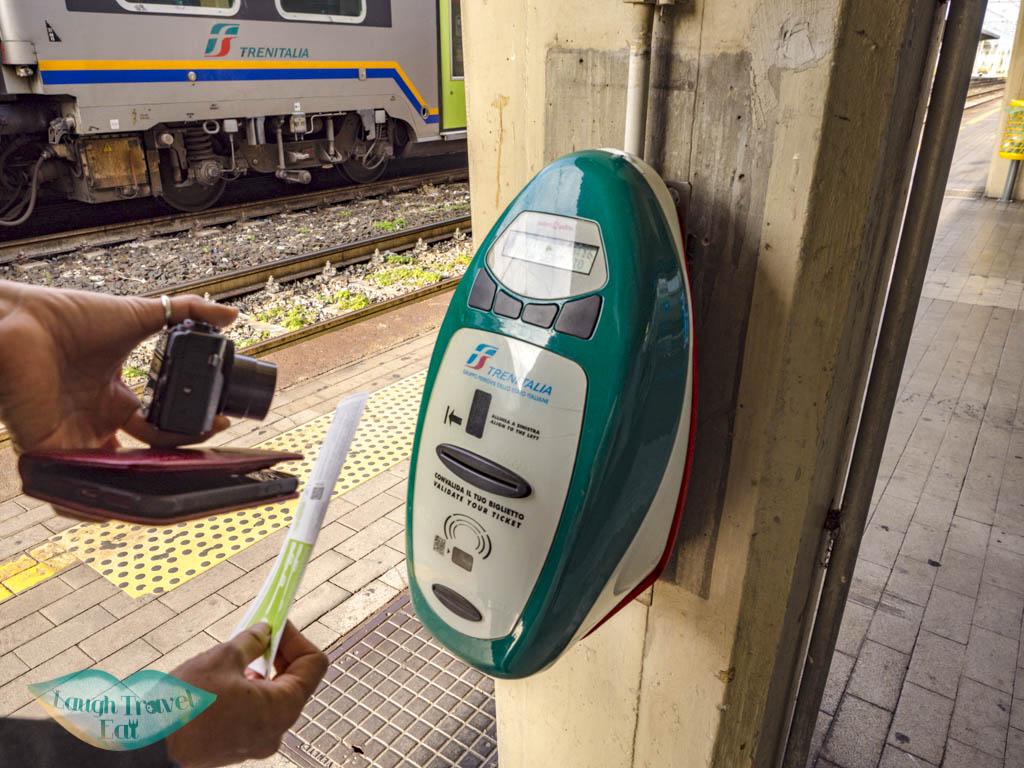 train ticket buying and validating italy - laugh travel eat