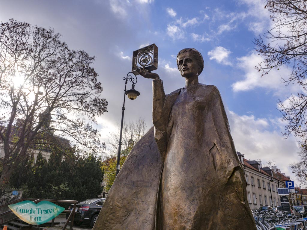 marie curie statue warsaw poland - laugh travel eat