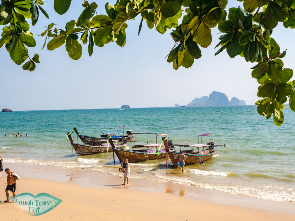longtail boat to railay beach ao nang krabi thailand - laugh travel eat