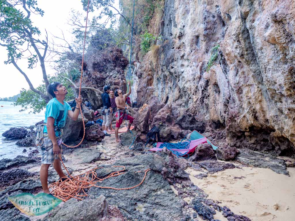 rock climbing set up railay east krabi thailand - laugh travel eat