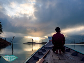 sunrise cheow lan lake khao sok thailand - laugh travel eat