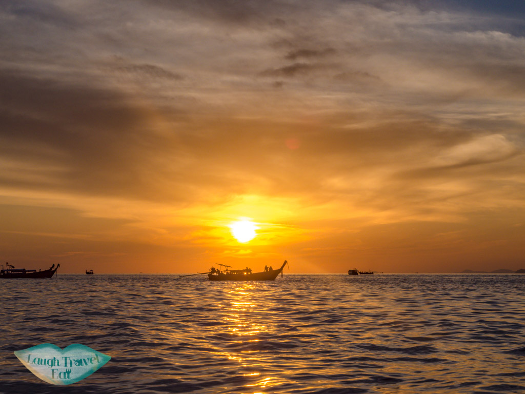 sunset on boat trip koh phi phi thailand - laugh travel eat