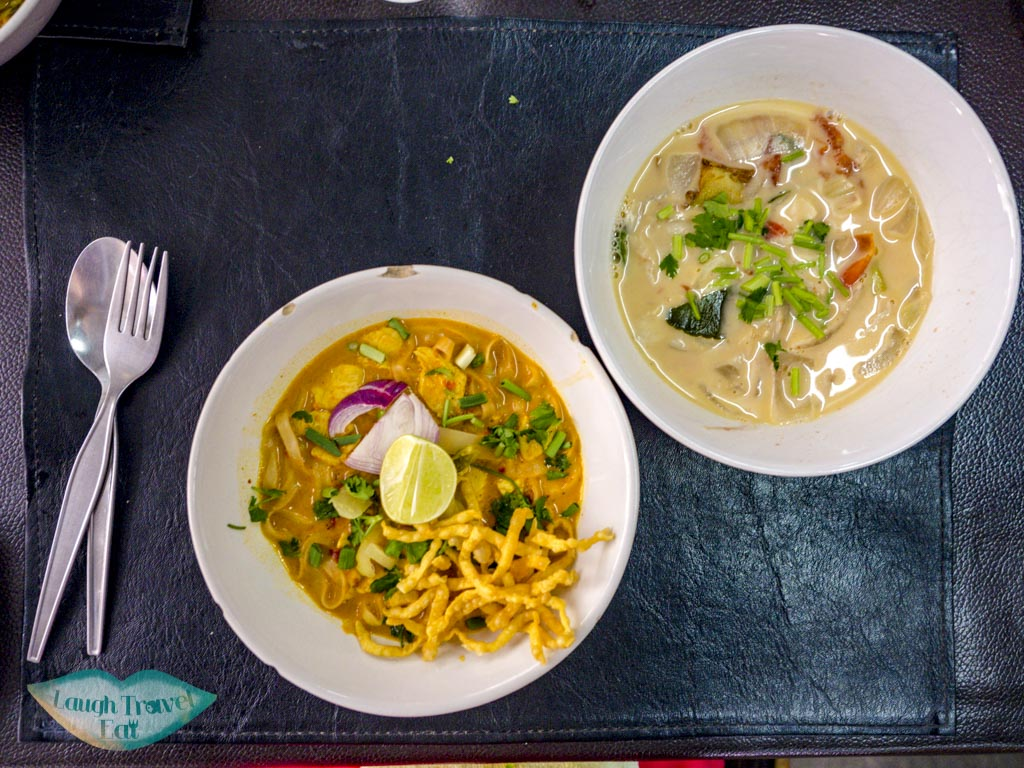 khao soi and coconut soup backstreet academy asia scenic cooking class chiang mai thailand - laugh travel eat