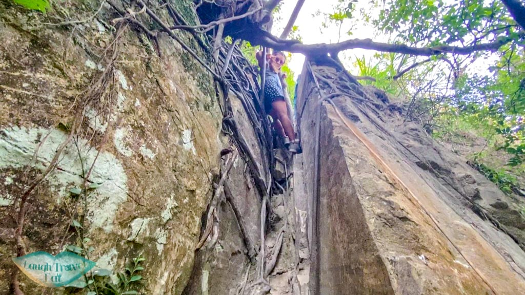 getting out of open book cliff pak lung stream lantau island hong kong - laugh travel eat