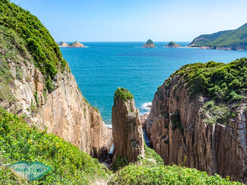 clasped hand rock bluff island sai kung hong kong - laugh travel eat