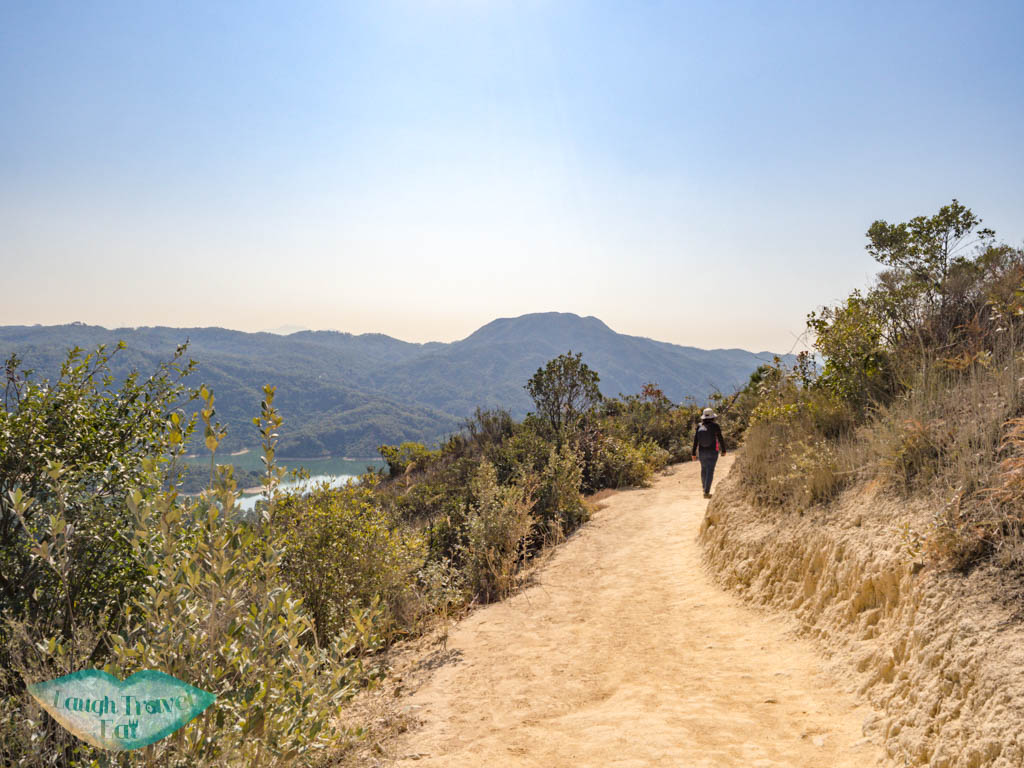 on route of reservoir island viewpoint tai lam country park yuen long hong kong - laugh travel eat