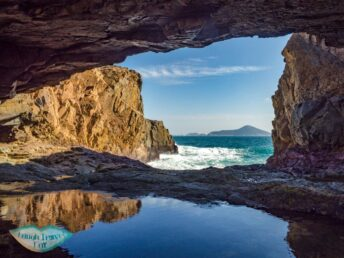 under the arch crab cave cape d'aguilar south hong kong - laugh travel eat