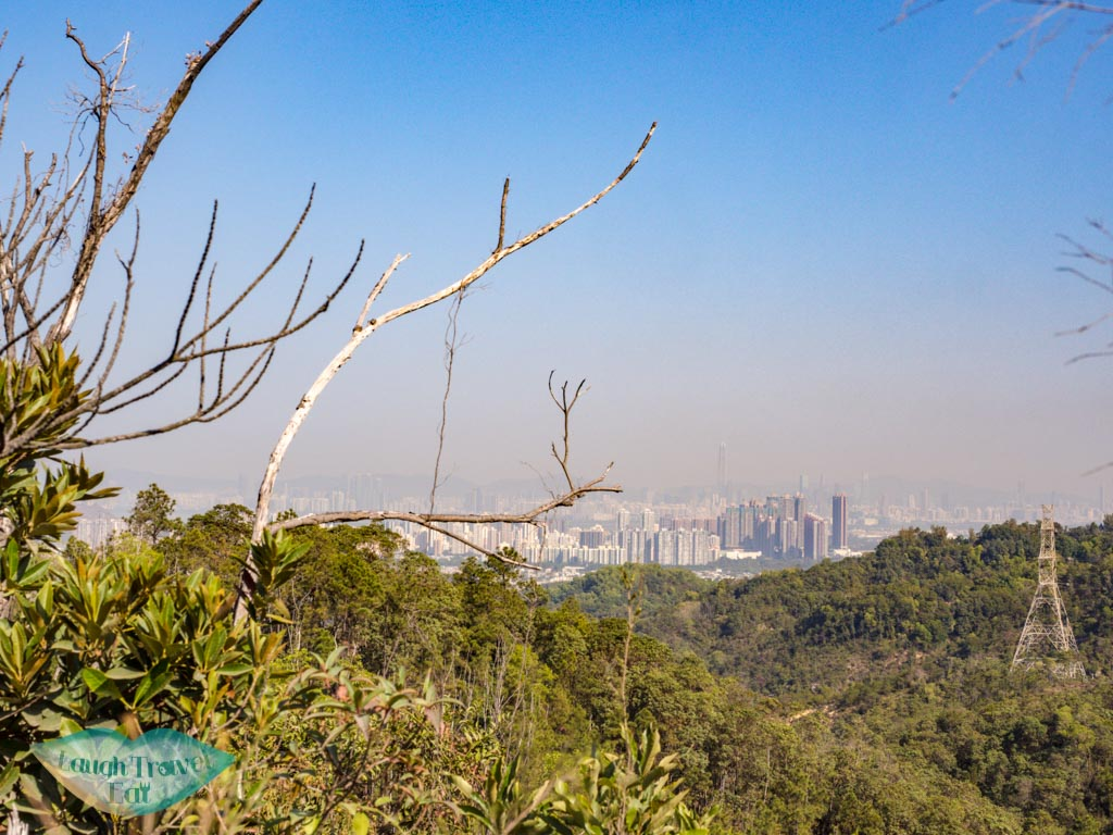 view of shenzhen on the way to reservoir island viewpoint tai lam country park yuen long hong kong - laugh travel eat